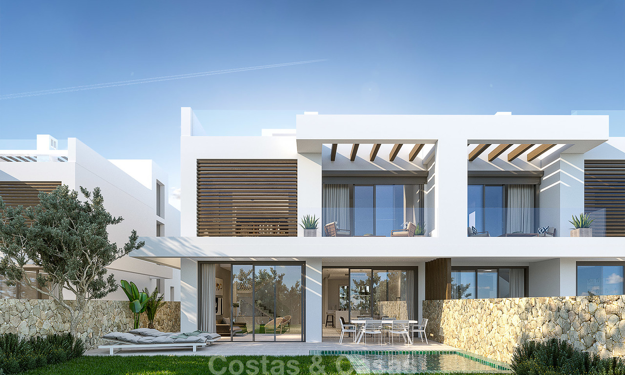 New contemporary semi-detached houses for sale in a boutique development, first line golf in a gated resort, Marbella 3703
