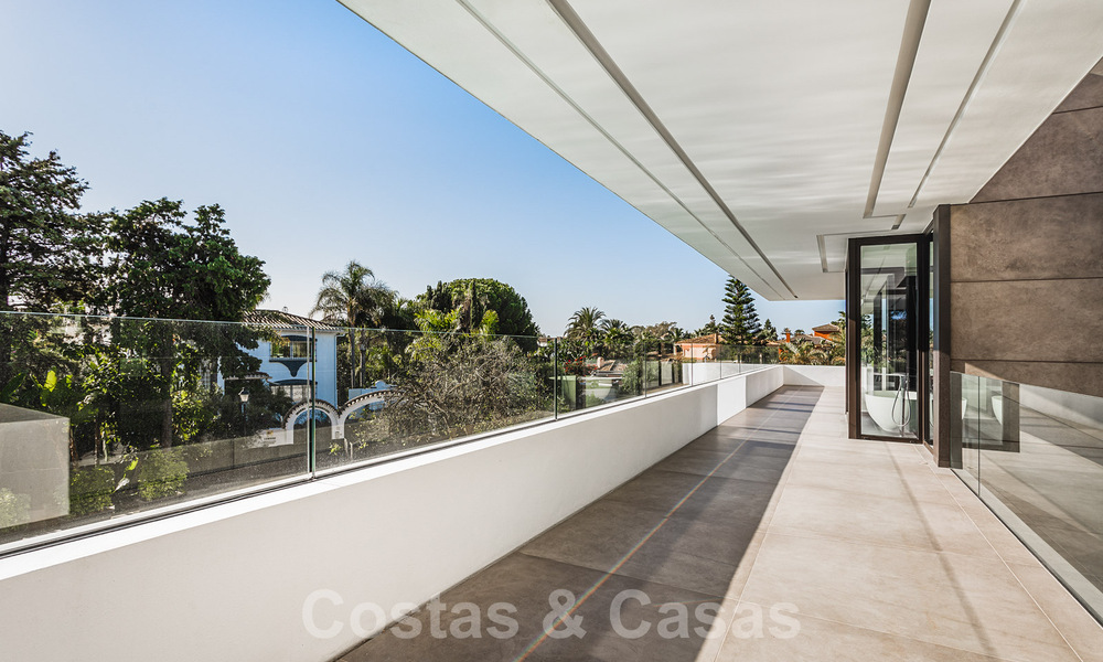 Brand new, beach side ultra-modern designer style villa for sale, Estepona East - Marbella. Ready to move in. 30728