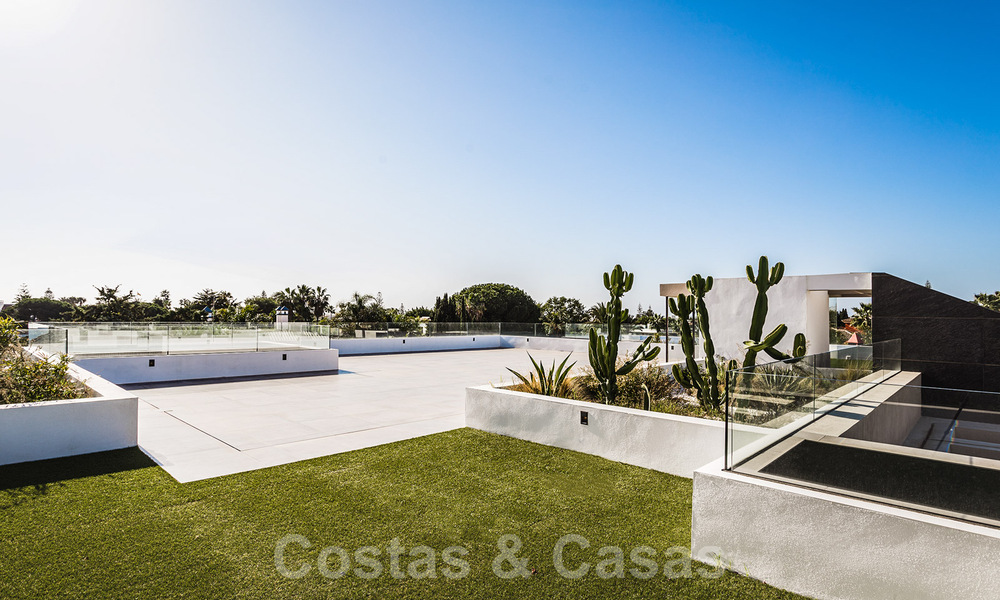 Brand new, beach side ultra-modern designer style villa for sale, Estepona East - Marbella. Ready to move in. 30737