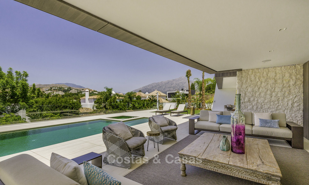 Impressive contemporary style luxury villa for sale in Nueva Andalucía, Marbella. Ready to move in and quality furnished. 15334