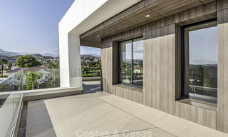 Impressive contemporary style luxury villa for sale in Nueva Andalucía, Marbella. Ready to move in and quality furnished. 15578