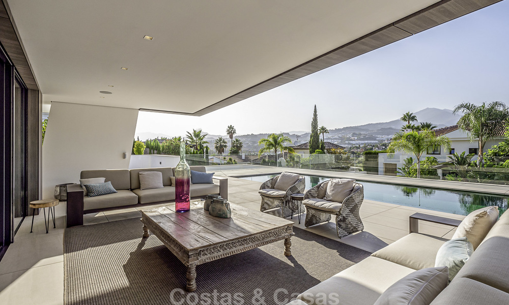 Impressive contemporary style luxury villa for sale in Nueva Andalucía, Marbella. Ready to move in and quality furnished. 15584