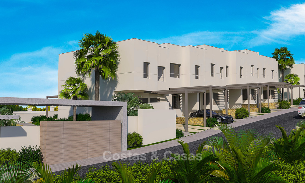 New, modern and exclusive golf townhouses with spectacular golf views for sale in Estepona. Discount! 12141