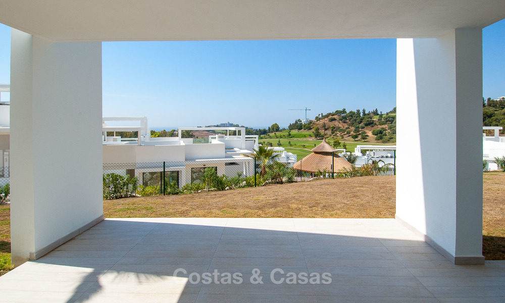 New, modern raised garden apartment with golf, mountain- and sea-views for sale in Benahavis - Marbella 5800
