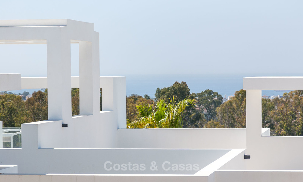 New, modern raised garden apartment with golf, mountain- and sea-views for sale in Benahavis - Marbella 5812