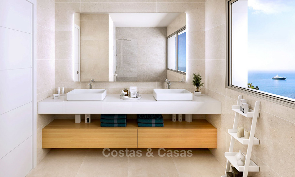 Stunning new contemporary-style townhouses with sea views for sale, in a prestigious resort - Mijas Costa, Costa del Sol 7617