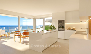 Stunning new contemporary-style townhouses with sea views for sale, in a prestigious resort - Mijas Costa, Costa del Sol 7619