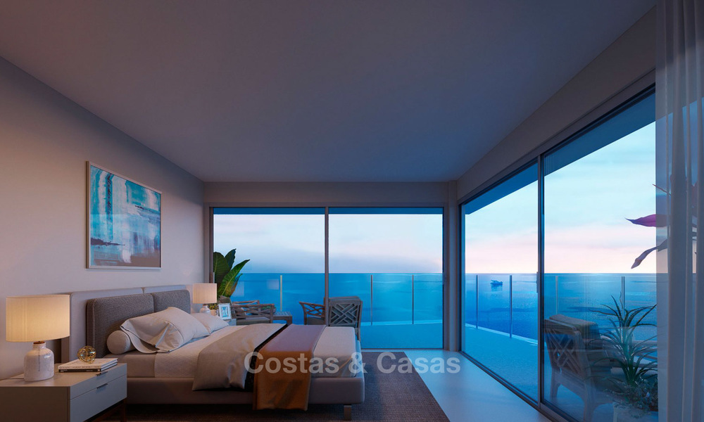 Stunning new contemporary-style townhouses with sea views for sale, in a prestigious resort - Mijas Costa, Costa del Sol 7620