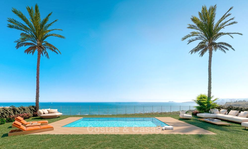 Stunning new contemporary-style townhouses with sea views for sale, in a prestigious resort - Mijas Costa, Costa del Sol 7624