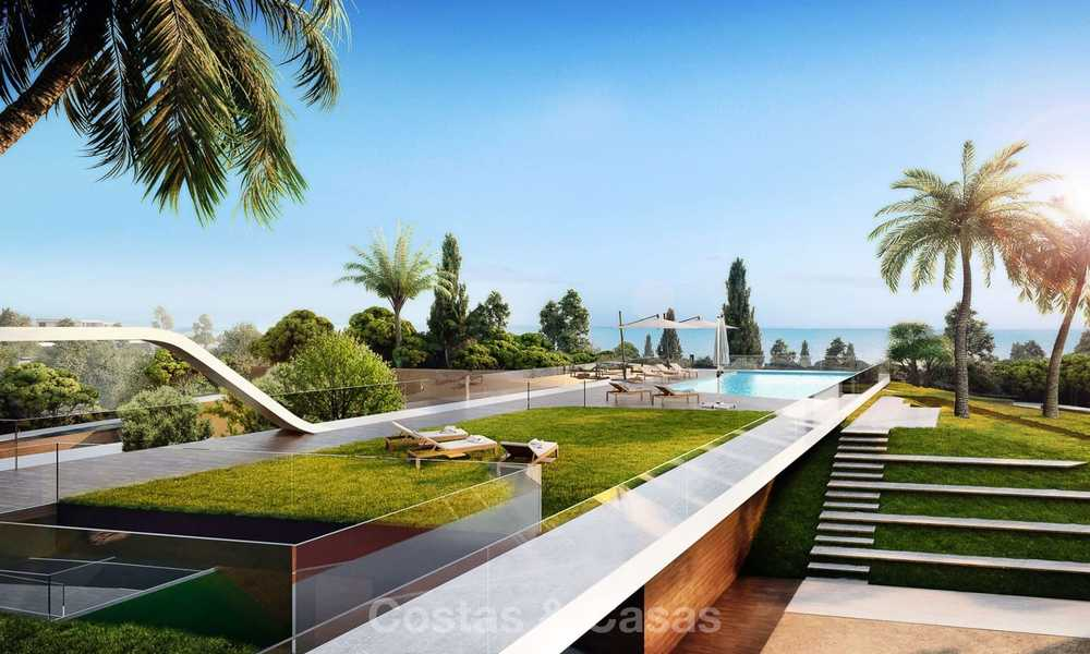 Stunning new contemporary-style townhouses with sea views for sale, in a prestigious resort - Mijas Costa, Costa del Sol 7627