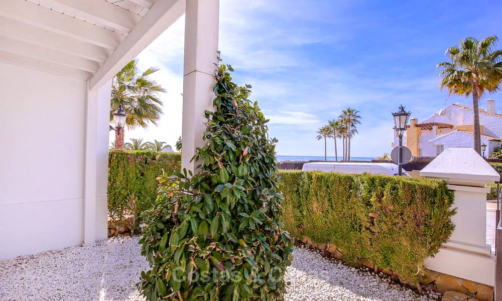 Spacious semi-detached house with magnificent sea views for sale, in a prestigious beach front complex - East Marbella 10052