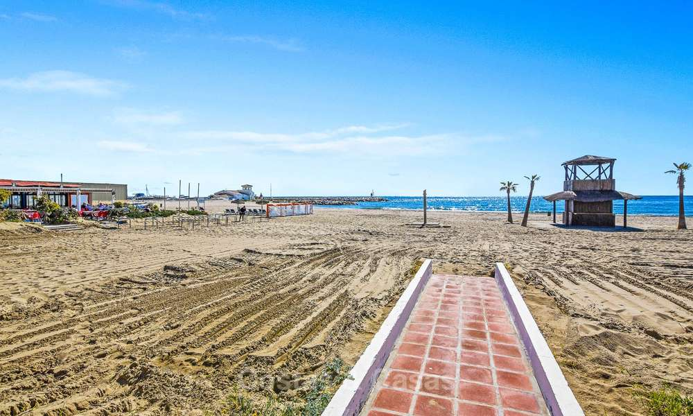 Charming, very spacious duplex ground floor apartment for sale, frontline beach and marina in Cabopino, East Marbella 10268