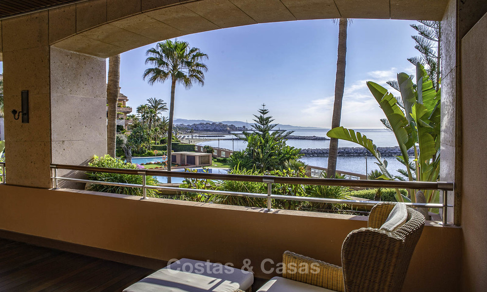 Luxury frontline beach apartment for sale in an exclusive residential complex, Puerto Banus, Marbella 11553