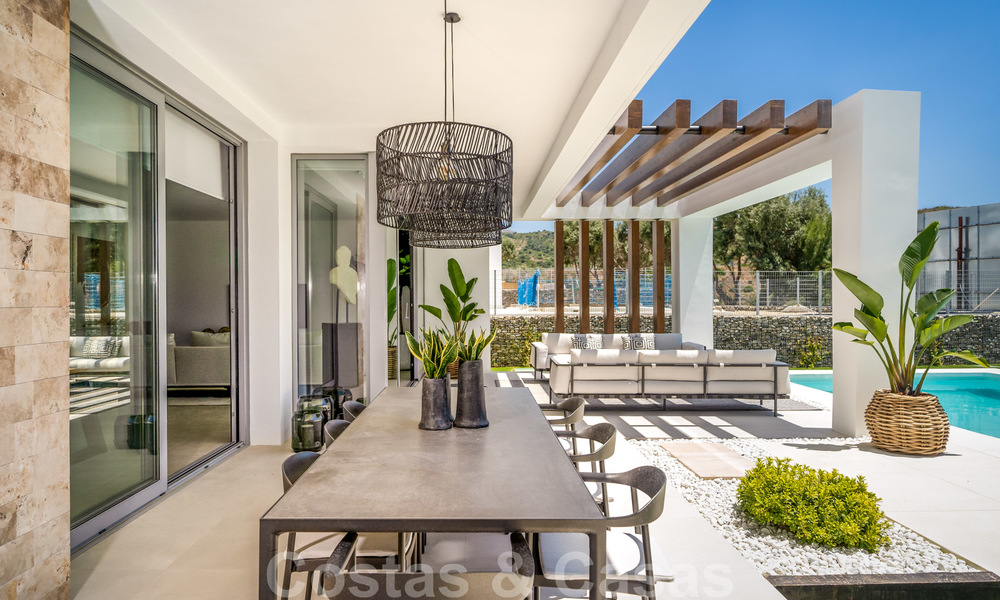 Exclusive contemporary golf villas with stunning golf and sea views for sale - East Marbella 26707