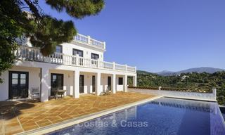 Charming traditional style villa with sea and mountain views for sale in El Madroñal, Benahavis, Marbella 12634