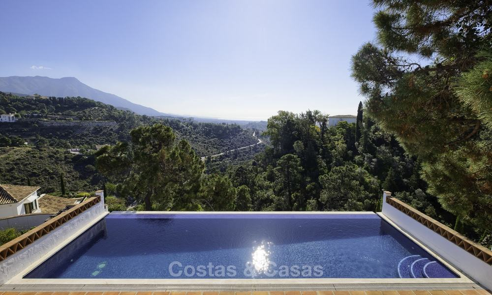 Charming traditional style villa with sea and mountain views for sale in El Madroñal, Benahavis, Marbella 12639