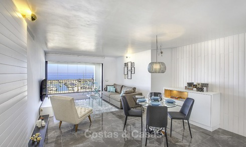 Fully renovated modern luxury apartment for sale in the marina of Puerto Banus with panoramic views over the port and the sea, Marbella. Bottom price! 12747