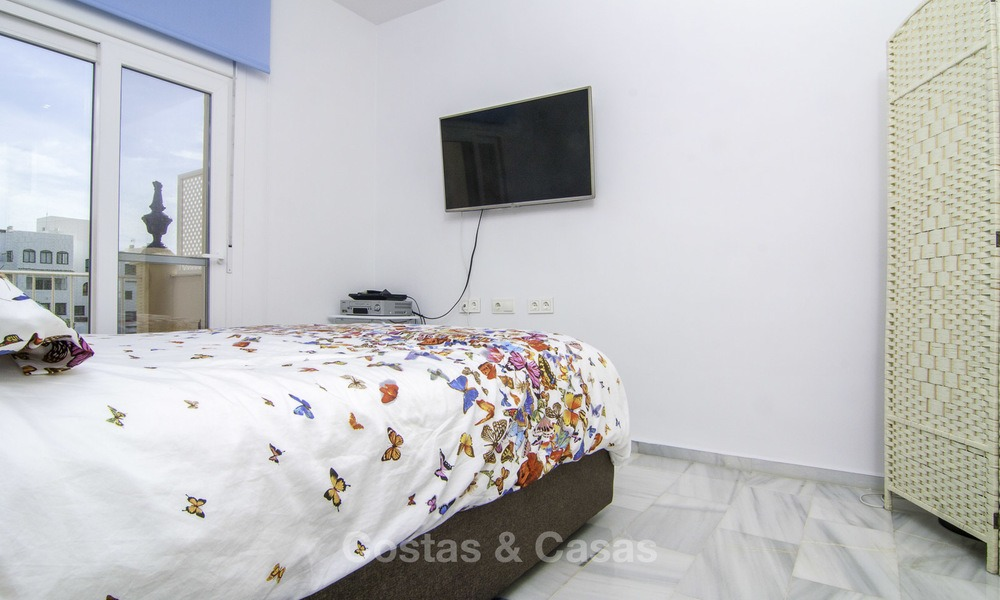 Attractive penthouse apartment with amazing sea views in a frontline beach complex for sale, Puerto Banus, Marbella 13241