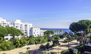 Attractive penthouse apartment with amazing sea views in a frontline beach complex for sale, Puerto Banus, Marbella 13247