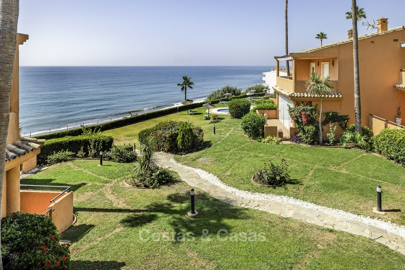 Beachfront renovated townhouse for sale with sea views in Estepona