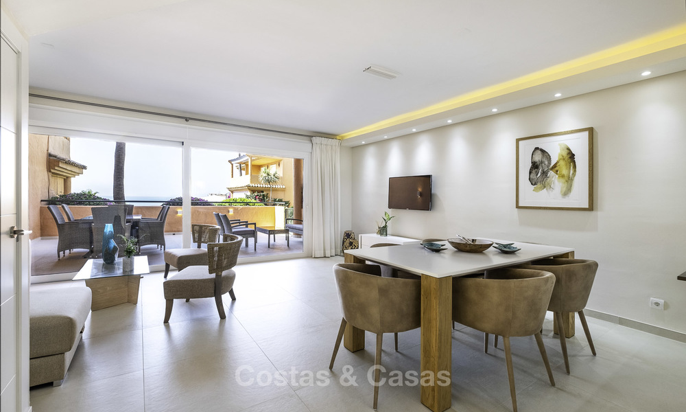 Spacious, fully renovated beachfront townhouse for sale in Estepona. Direct access to the beach and the beach promenade via the communal gardens. 15143