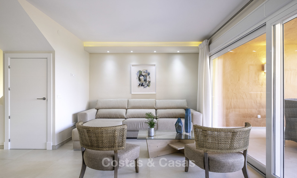 Spacious, fully renovated beachfront townhouse for sale in Estepona. Direct access to the beach and the beach promenade via the communal gardens. 15146
