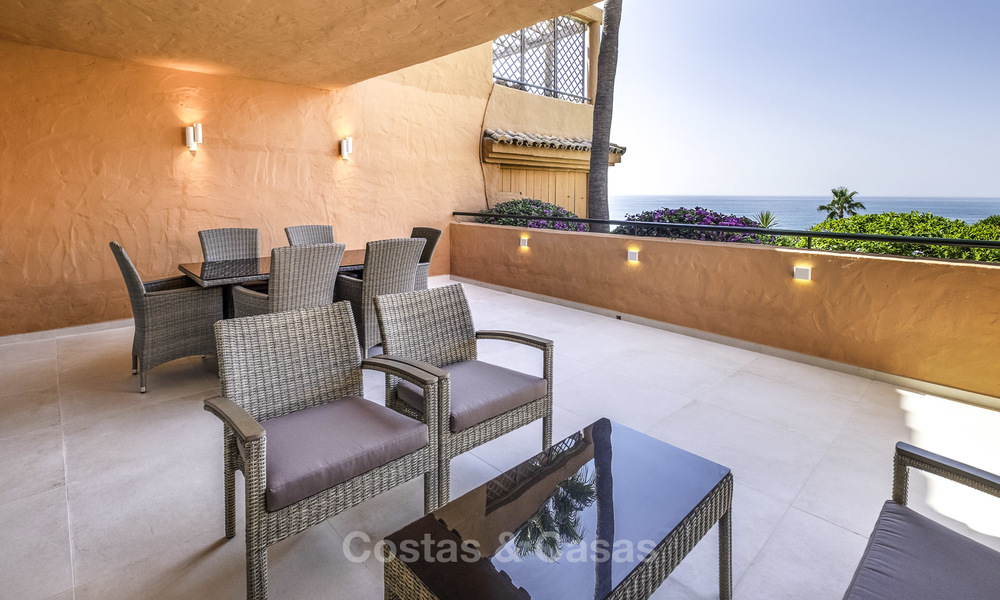 Spacious, fully renovated beachfront townhouse for sale in Estepona. Direct access to the beach and the beach promenade via the communal gardens. 15151
