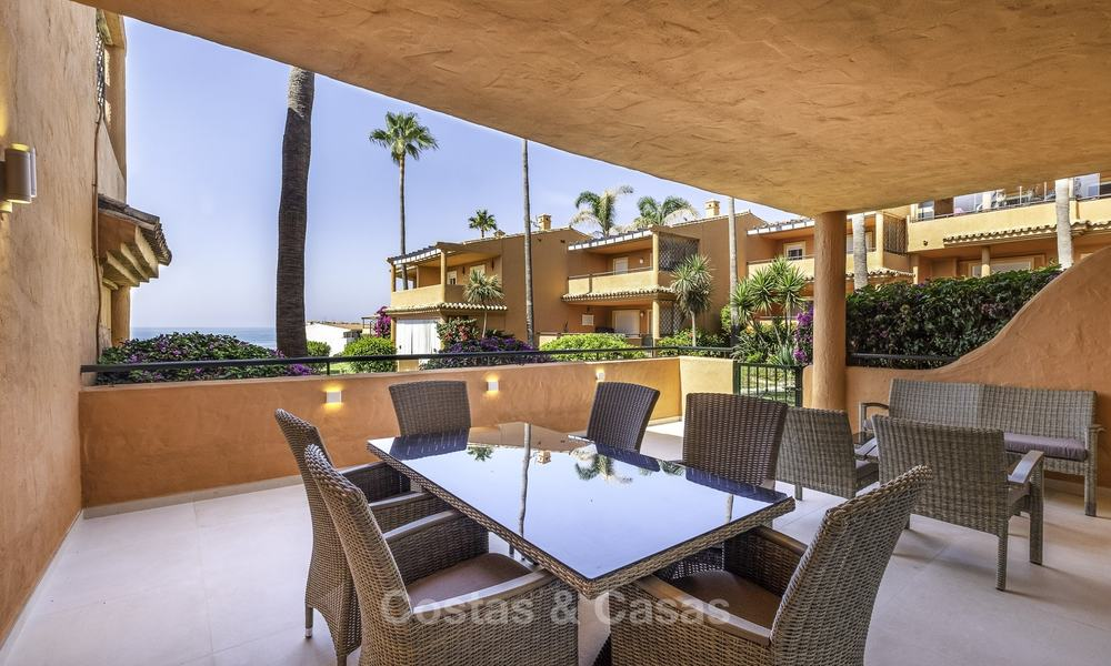 Spacious, fully renovated beachfront townhouse for sale in Estepona. Direct access to the beach and the beach promenade via the communal gardens. 15152