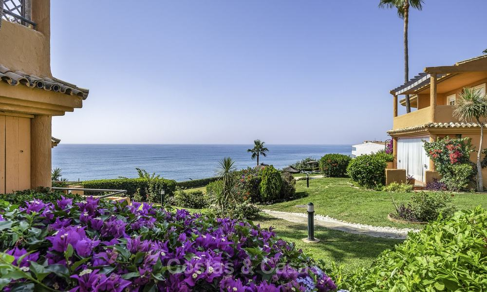 Spacious, fully renovated beachfront townhouse for sale in Estepona. Direct access to the beach and the beach promenade via the communal gardens. 15153