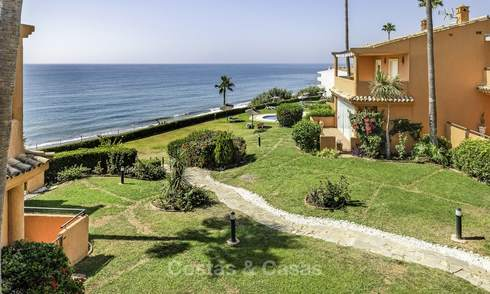 Spacious, fully renovated beachfront townhouse for sale in Estepona. Direct access to the beach and the beach promenade via the communal gardens. 15162