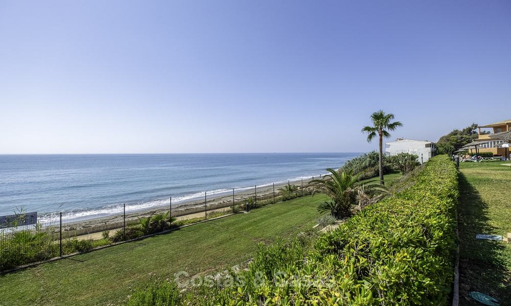 Spacious, fully renovated beachfront townhouse for sale in Estepona. Direct access to the beach and the beach promenade via the communal gardens. 15169