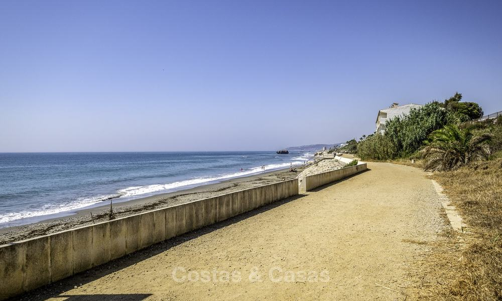 Spacious, fully renovated beachfront townhouse for sale in Estepona. Direct access to the beach and the beach promenade via the communal gardens. 15172