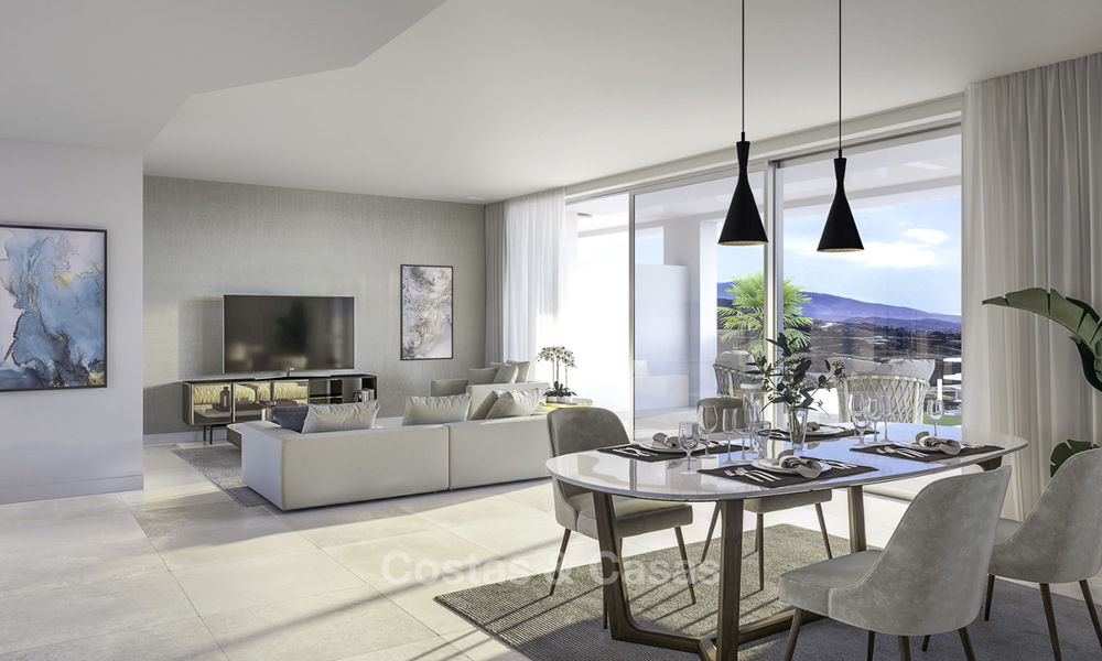 New deluxe contemporary townhouses for sale, front line golf, with stunning sea and golf views, East Marbella 16729