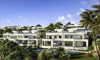New deluxe contemporary townhouses for sale, front line golf, with stunning sea and golf views, East Marbella 16739