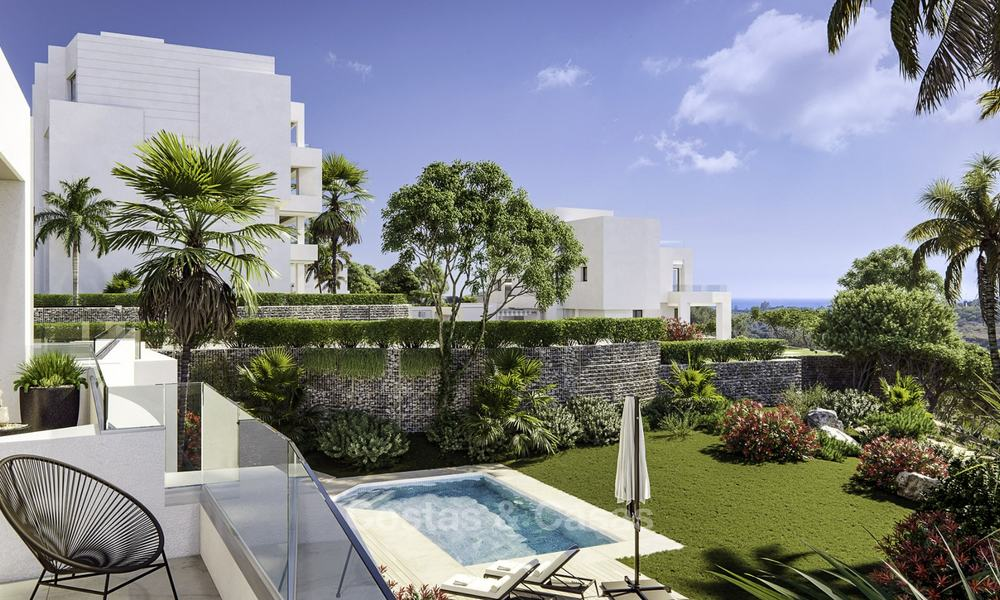 New deluxe contemporary townhouses for sale, front line golf, with stunning sea and golf views, East Marbella 16740