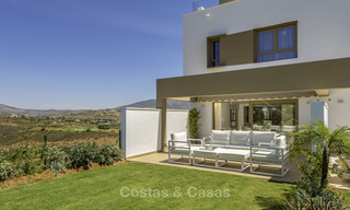 New, move-in ready, modern townhouses for sale on an acclaimed golf resort in Mijas, Costa del Sol. 10% discount! 15660