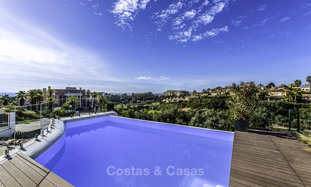 New contemporary designer villa for sale, ready to move into, with sea, golf and mountain views, East Marbella 17505