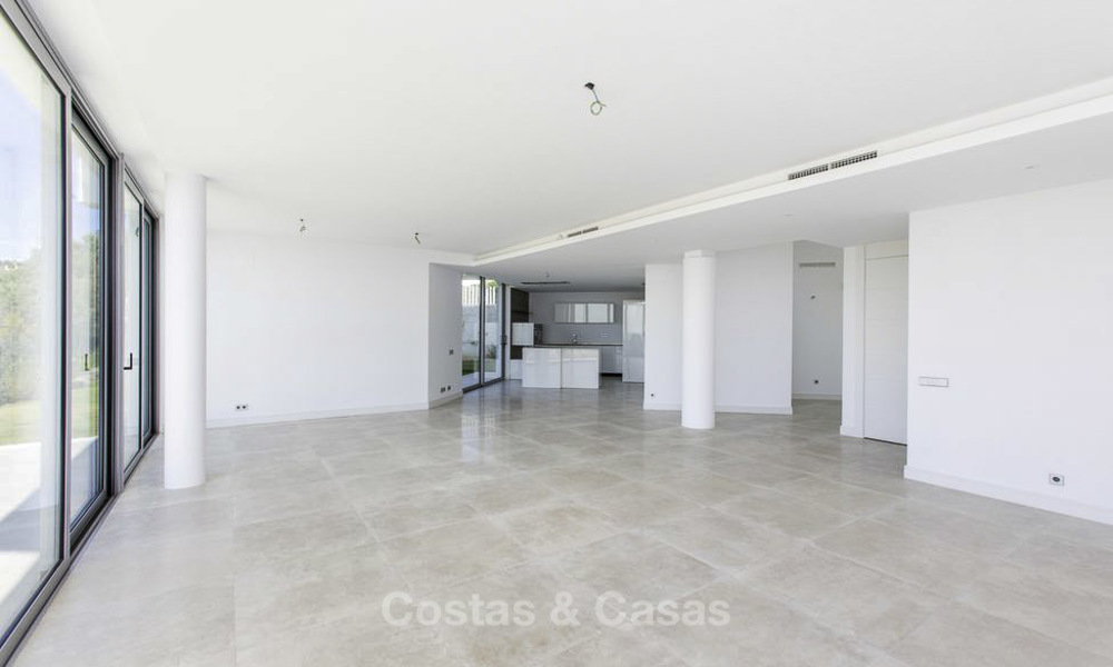 New contemporary designer villa for sale, ready to move into, with sea, golf and mountain views, East Marbella 17513