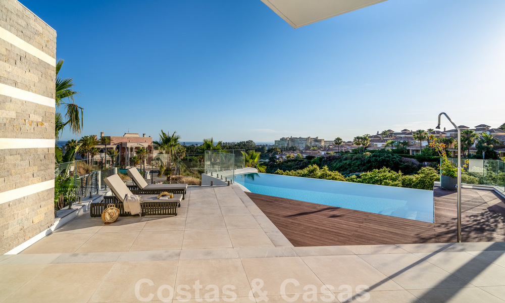 New contemporary designer villa for sale, ready to move into, with sea, golf and mountain views, East Marbella 26771