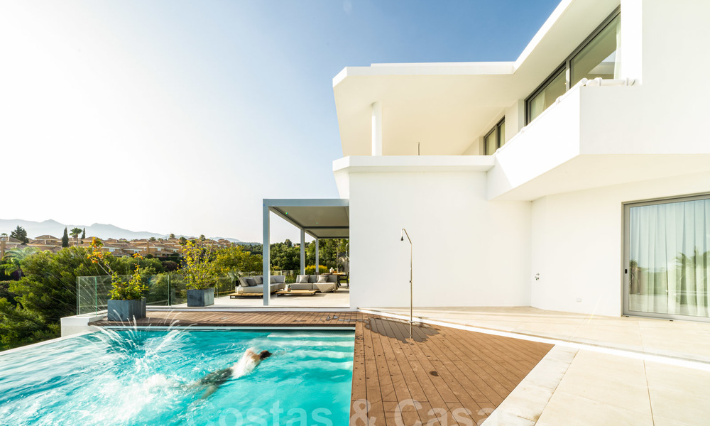 New contemporary designer villa for sale, ready to move into, with sea, golf and mountain views, East Marbella 26790
