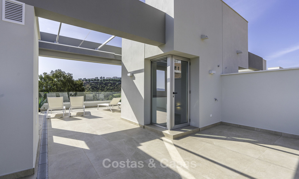 Spacious new built contemporary townhouses for sale, in a championship golf resort in Mijas 17789