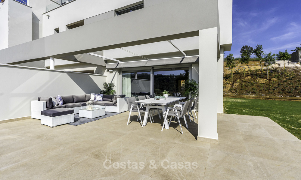 Spacious new built contemporary townhouses for sale, in a championship golf resort in Mijas 17803