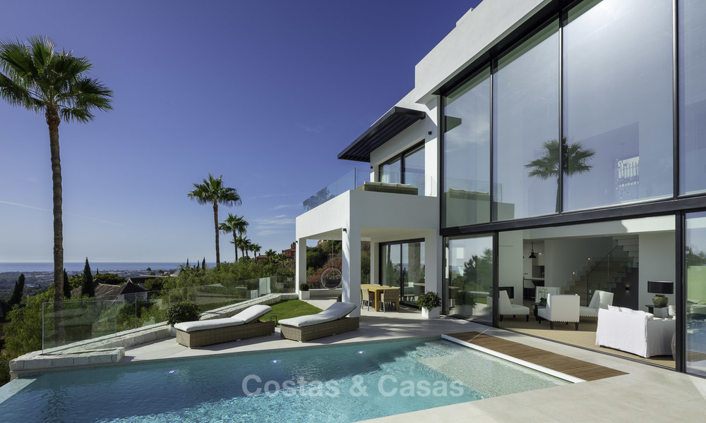Brand new, move-in-ready contemporary luxury villa with stunning sea views for sale in a sought-after golf club, Benahavis - Marbella 19550