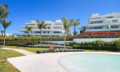 New ready to move in modern design apartment for sale, on the golf course between Marbella and Estepona 24858