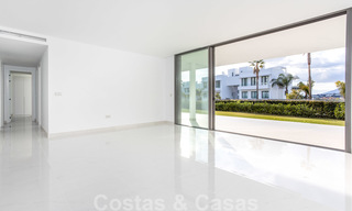 Modern design apartment for sale with spacious terrace and large garden, adjacent to the golf course in Marbella - Estepona 25394