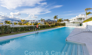 Modern design apartment for sale with spacious terrace and large garden, adjacent to the golf course in Marbella - Estepona 25406