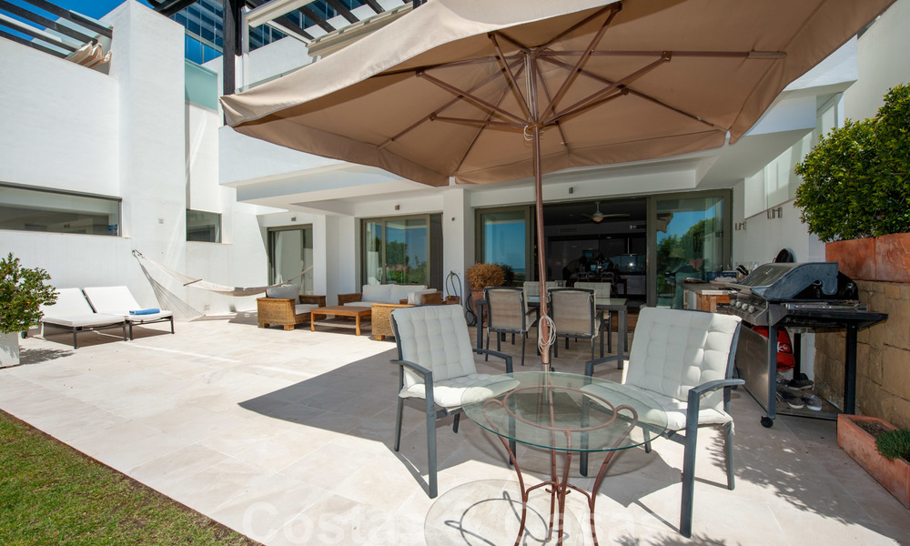 Modern front-line golf apartment with beautiful golf and sea views for sale in Los Flamingos Golf in Marbella - Benahavis 25125