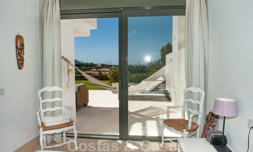 Modern front-line golf apartment with beautiful golf and sea views for sale in Los Flamingos Golf in Marbella - Benahavis 25141