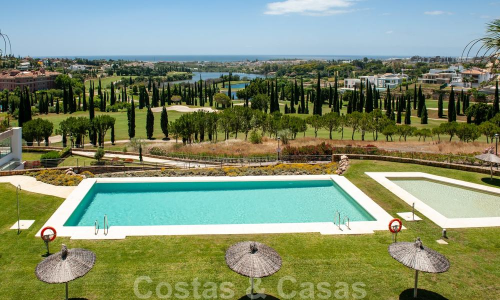 Modern front-line golf apartment with beautiful golf and sea views for sale in Los Flamingos Golf in Marbella - Benahavis 25156