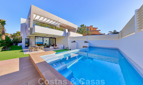Modern, semi-detached villas for sale at 300 meters from the beach in Puerto Banus, Marbella 31677